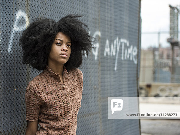 Portrait of young woman with afro hair
