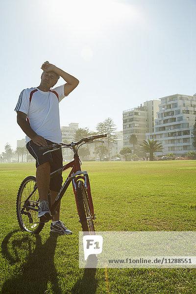 Man Taking a Break from Biking