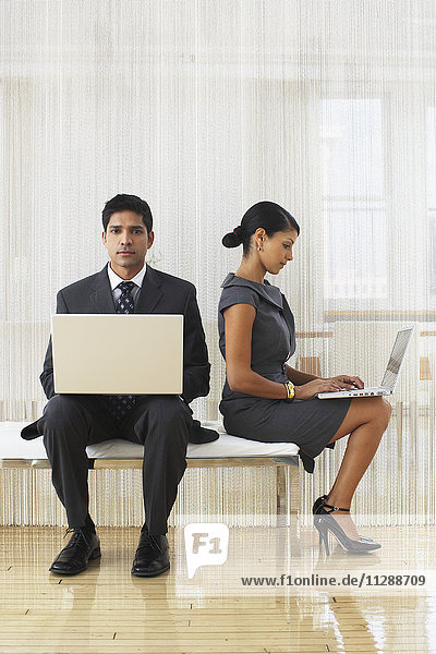 Businesspeople with Laptop Computers
