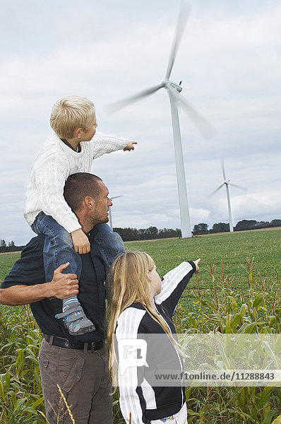 Father and Children Looking at Wind Turbines  Denmark