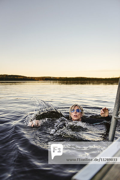 Woman swimming in lake