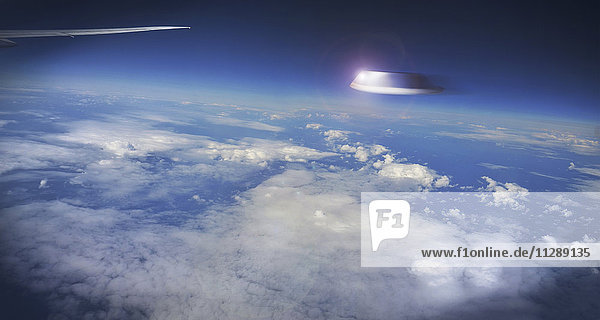 View of UFO Outside Airplane Window