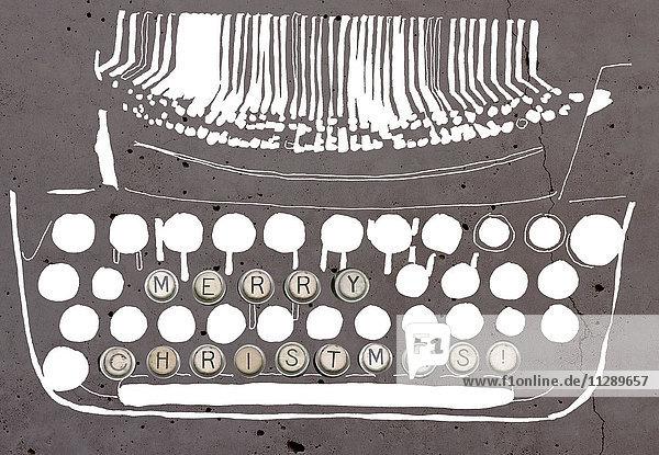 Frohe Weihnachten auf der Schreibmaschinentaste einer stilisierten Schreibmaschine
