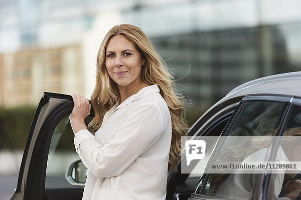 Woman near car
