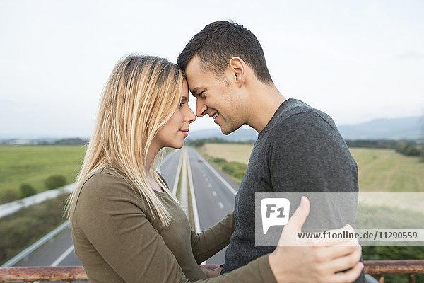 Young couple on motorway bridge
