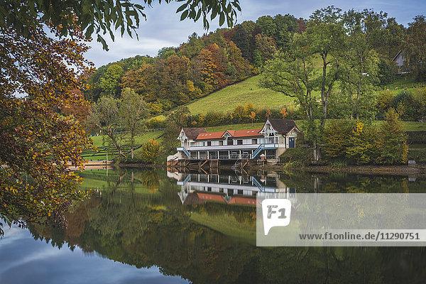 Switzerland  St. Gallen  bathhouse at Mannenweiher in autumn