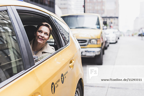 USA  New York City  smiling woman in taxi