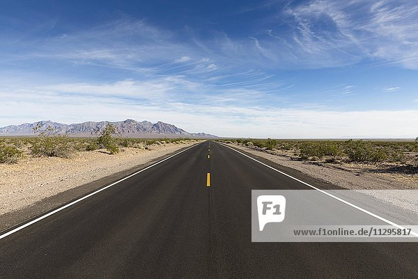 Lonely long road  Death Valley National Park  California  USA  North America