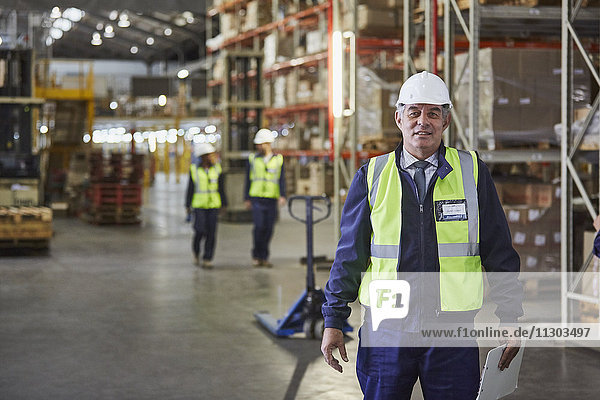 Portrait confident manager in distribution warehouse