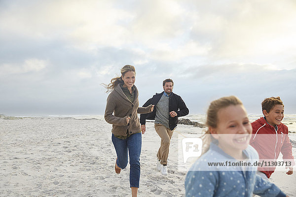 Playful family running on beach