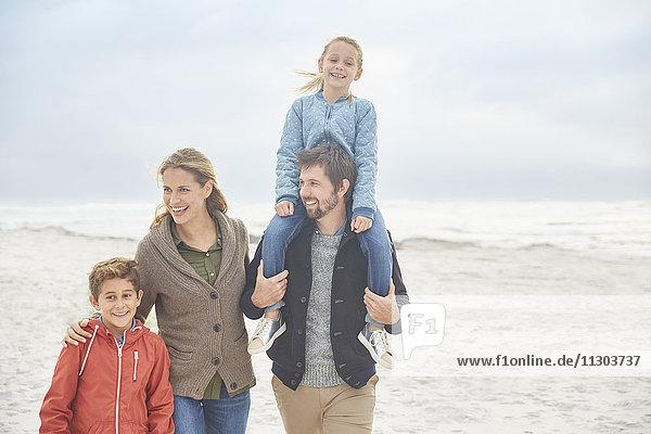 Family walking on winter beach