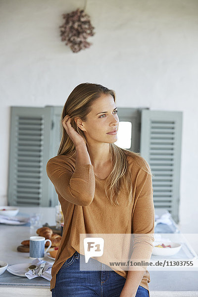 Serene woman looking away on patio