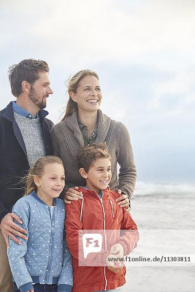 Smiling family on winter beach