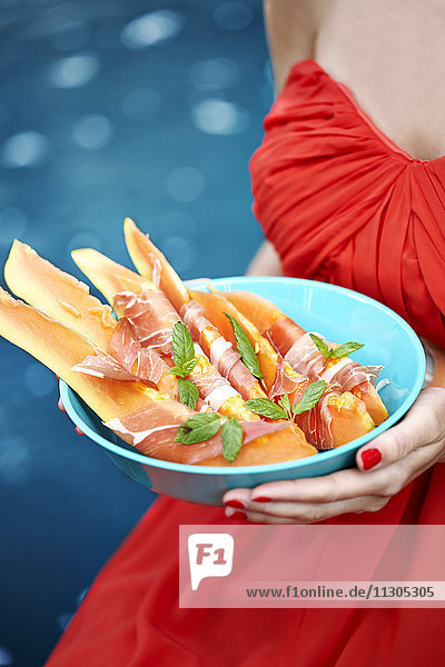 Woman holding food in bowl
