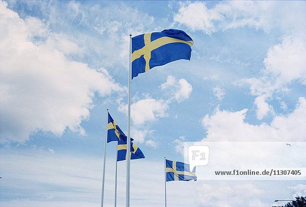 Swedish flags against sky