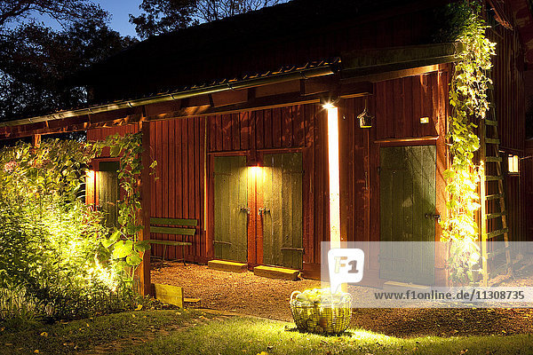 Illuminated wooden house