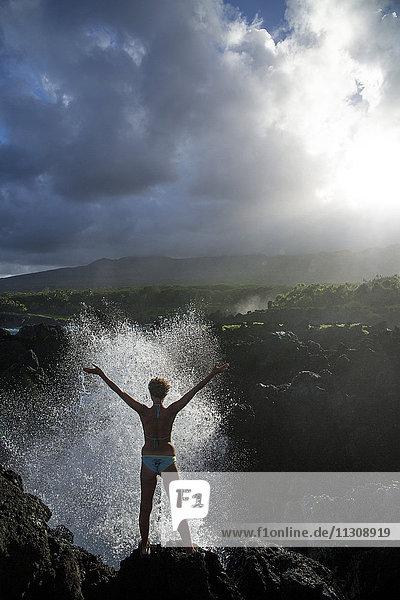 Maui  Wai'anapanapa  State park  coast  USA  Hawaii  America  rock  cliff  stone  mountains  woman  foam  surf  joy  stretch  water