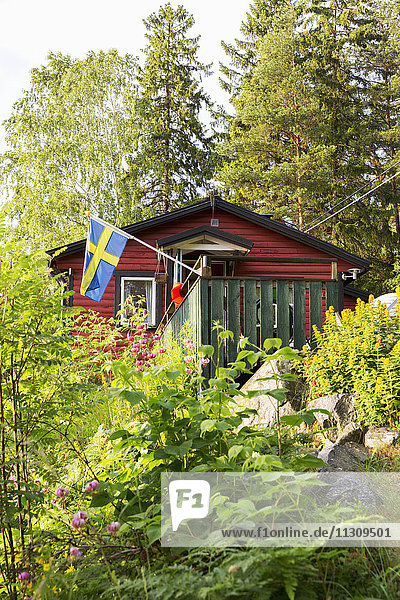 Wooden house with Swedish flag