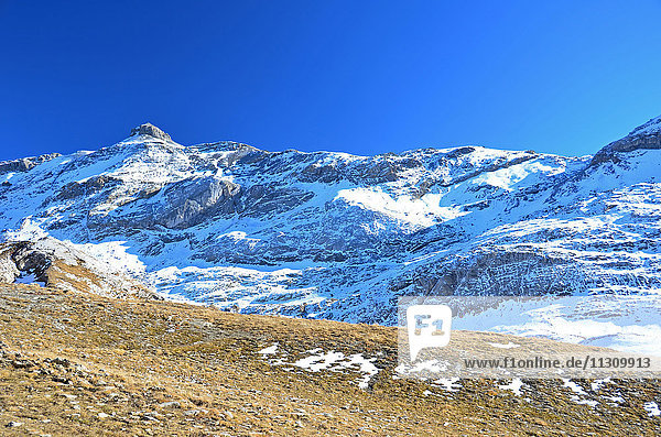 The Weisshorn in the Bernese Alps (central Switzerland). In the snow the Wildstrubel mountain refuge