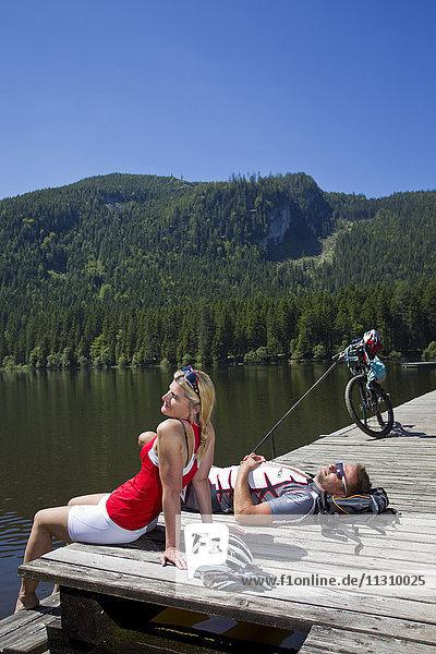 Bike  bicycle  mountain bike  sport  lake  take it easy  relax  couple  man  woman