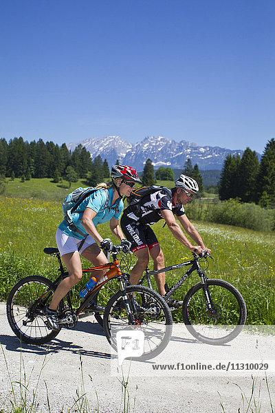 Bike  bicycle  scenery  Salzburg  Austria  helmet  bike  summer  sport  rest  fun  action  helmet  country lane  couple  man  woman