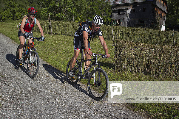 Bike  bicycle  scenery  Salzburg  Austria  helmet  bike  summer  sport  rest  fun  helmet  country lane  couple  man  woman