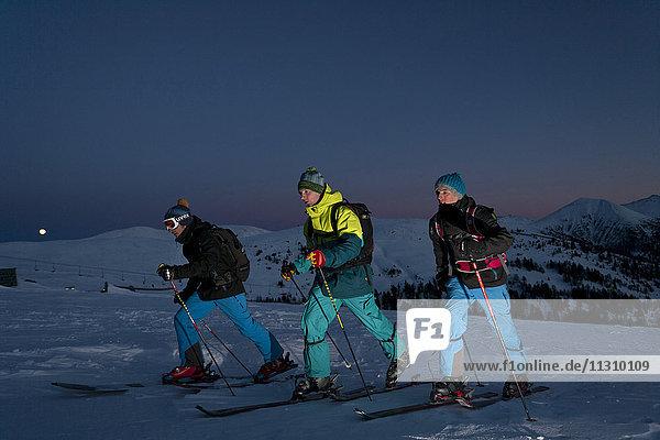 Ski tour  man  winter  Austria  sport  ski  at night  men  outdoor  group