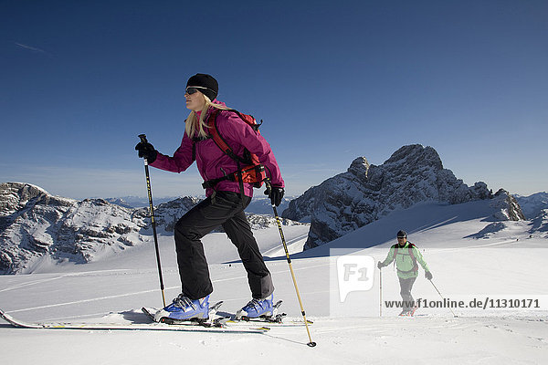 Ski tour  man  woman  couple  winter  sport  Dachstein  Styria  Austria  mountains