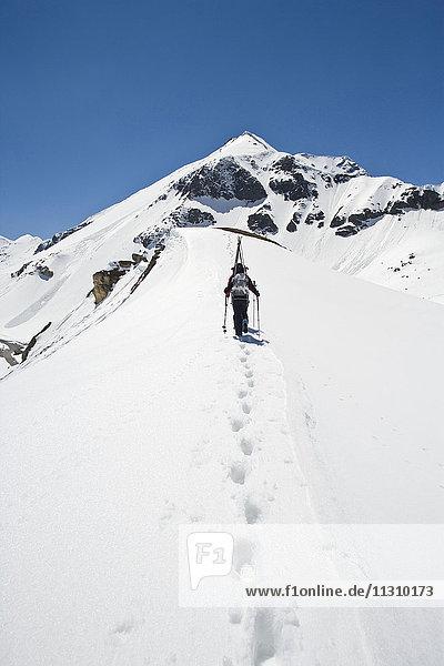 Ski tour  man  woman  couple  winter  sport  Dachstein  Styria  Austria  mountains  tracks  traces  summits  peaks