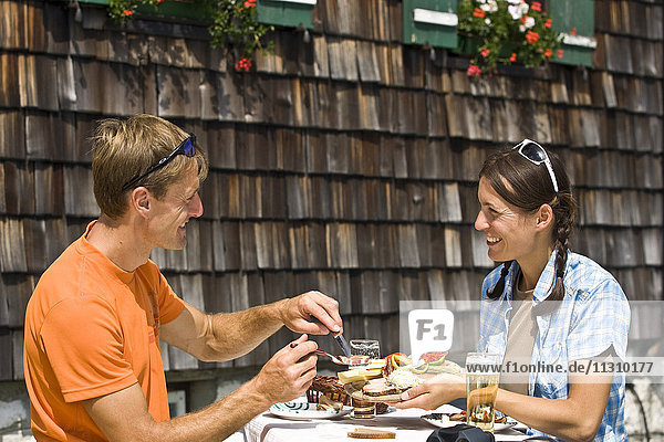 Austria  couple  walking  hiking  woman  man  rest  mountain hut  food  eating