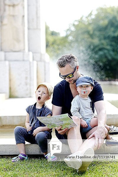 Portrait of father with sons in park