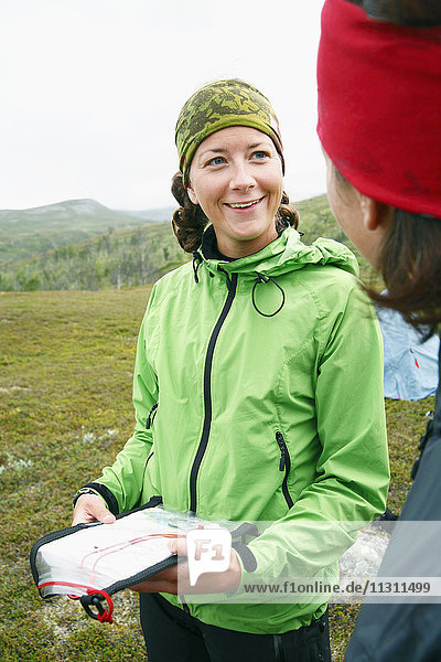 Female hikers using map