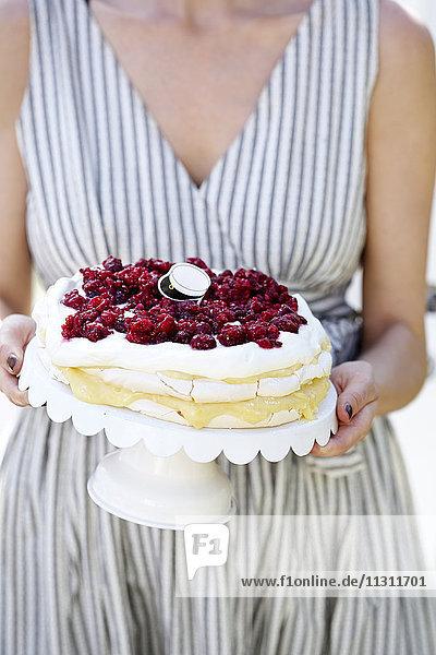 Woman holding cherry cake