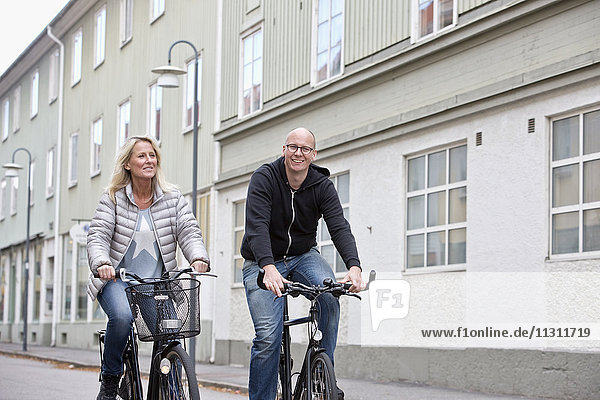 Couple cycling in street