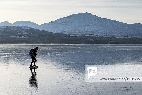 Young man moving on ice