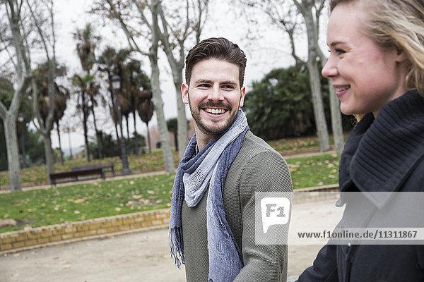 Happy couple walking in a park