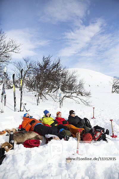 Friends relaxing on ski holiday