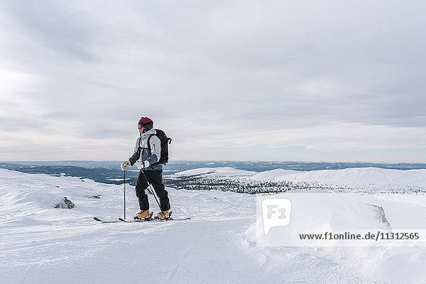 Skier skiing at sunny day
