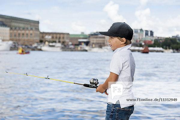 Boy fishing in city
