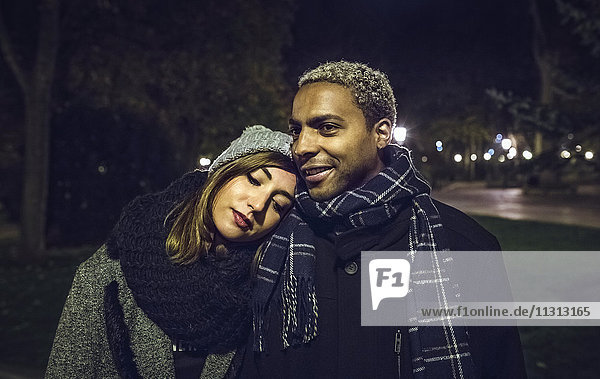 Portrait of young couple at park in winter