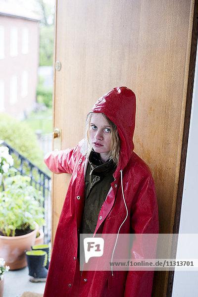 Portrait of girl wearing raincoat