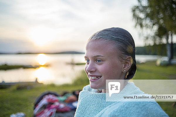 Girl by lake at sunset