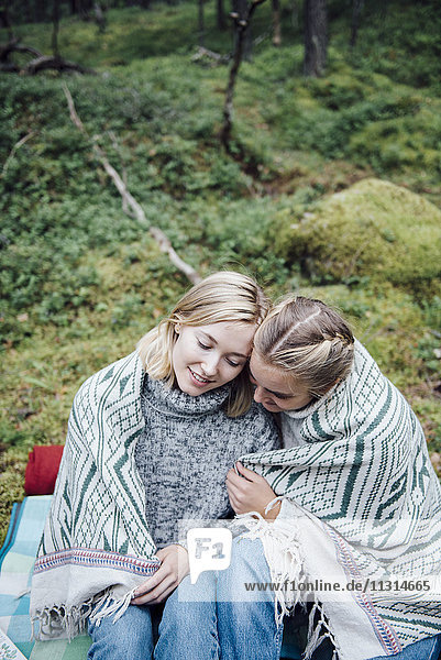 Two women having a picknick in the forest