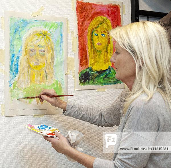 Woman painting portrait