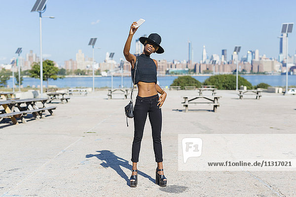 USA  New York City  Brooklyn  confident young woman taking a selfie