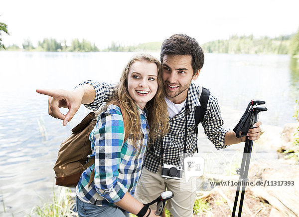Young couple on a hiking tour at a lake