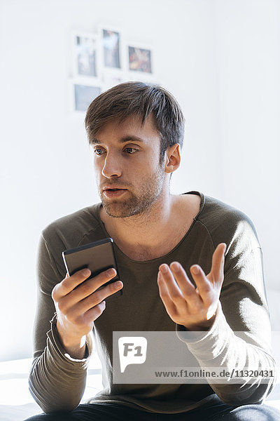 Young man on the phone at home