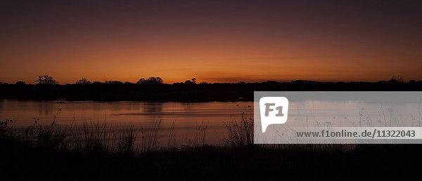Namibia  Sonnenuntergang in Okavango