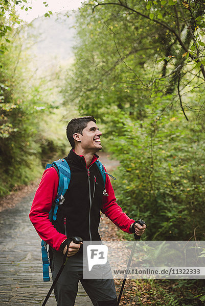 Happy hiker in forest