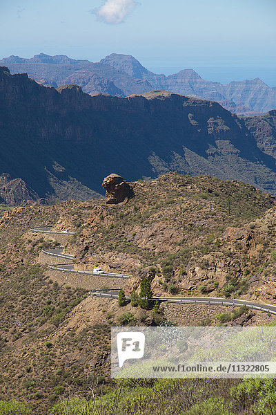 Gran Canaria  Canary islands  Spain  Europe  cliff  rocks  mountains  vegetation  volcanical  street